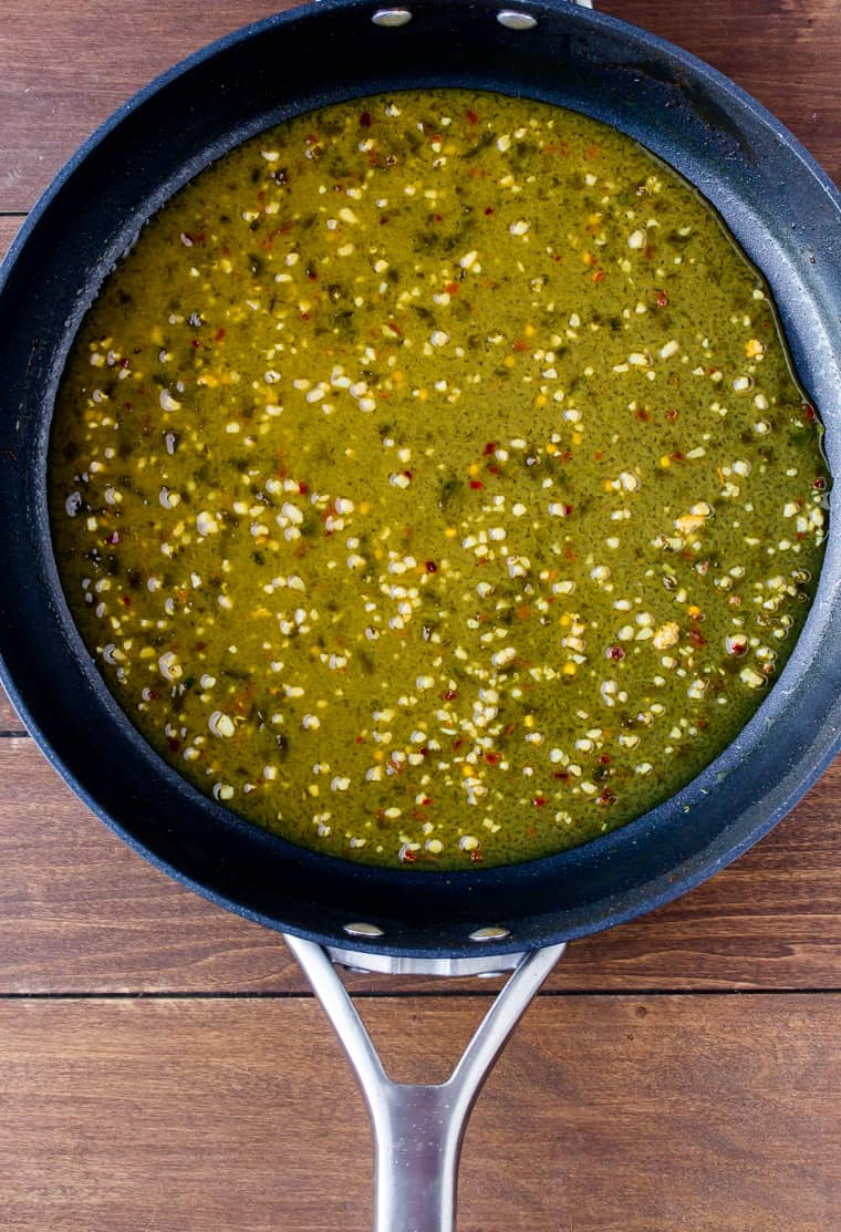 Overhead View of Cilantro Lime Sauce Cooking in a Skillet on a Wood Background