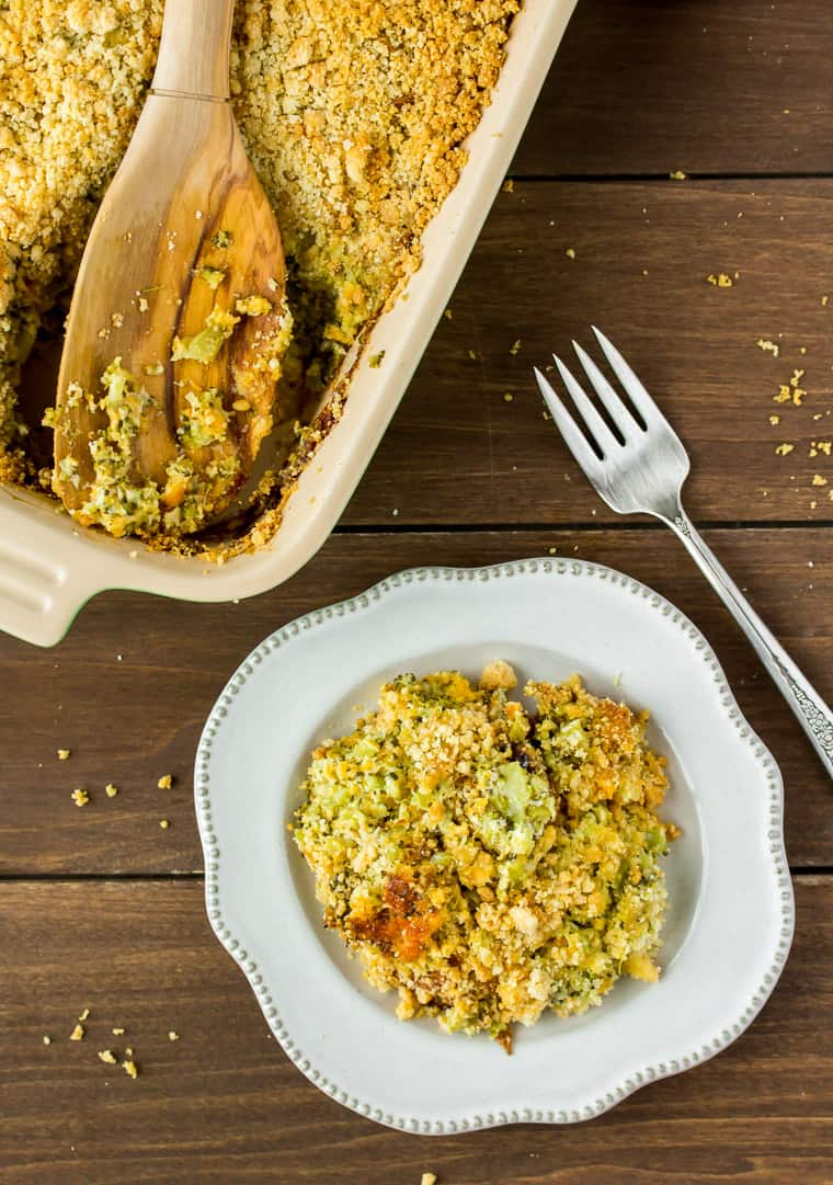 Keto Broccoli Casserole in a Baking Dish with a Serving on a Plate