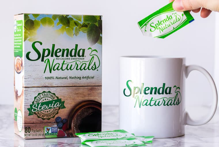 Splenda Naturals Box with a Mug and a Packet Being Poured into the Mug