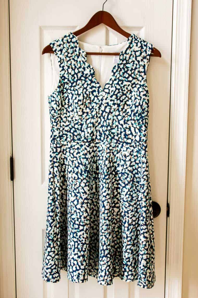 Stitch Fix Wisp Cleo Textured Knit Dress in multi-color print on a wood hanger in front of a white door