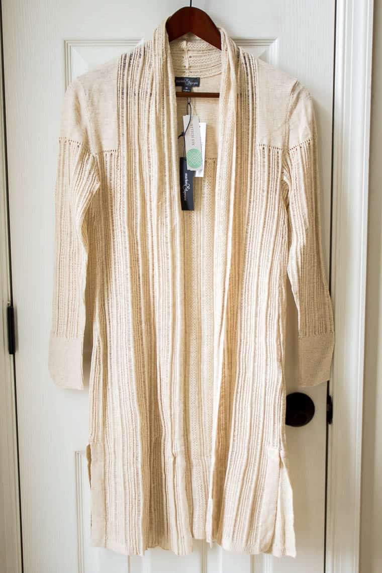 Market & Spruce Zonia Cotton Duster Cardigan in cream color from Stitch Fix hanging on a wood hanger in front of a white door
