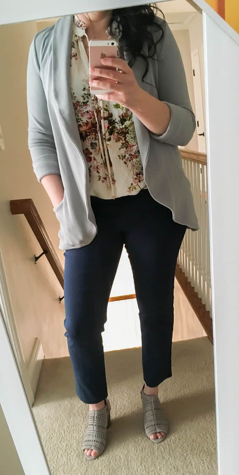 Outfit image of blue pants, cream shirt and gray blazer