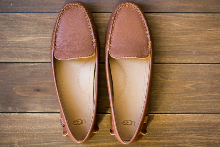 UGG Flores Driving Loafer in Cognac Leather on a wood backdrop