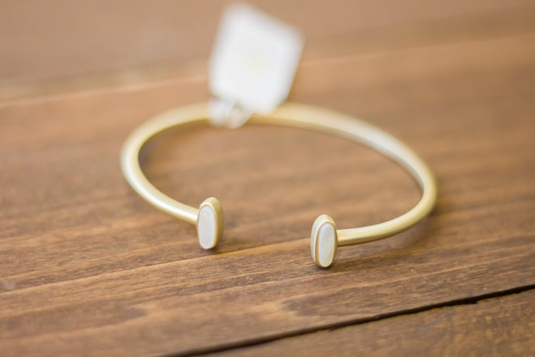 Kendra Scott Mavis Cuff in Ivory on a wood table