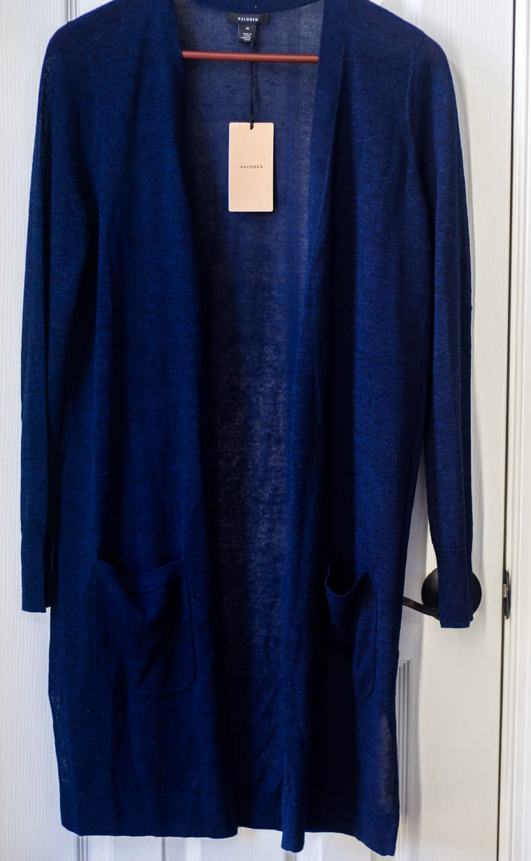 Halogen Long Linen Blend Cardigan in Navy on a hanger over a white door