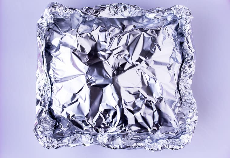 Foil packet all wrapped up on a white background