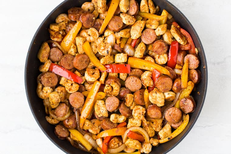 Keto Cajun Jambalaya in a black skillet over a white background