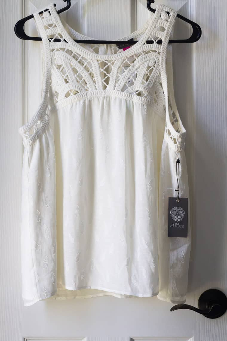 Stitch Fix Vince Camuto Monila Crochet Detail Texture Top in white on a hanger over a white door
