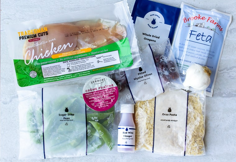 Ingredients for Blue Apron Mediterranean Chicken & Orzo on a white background
