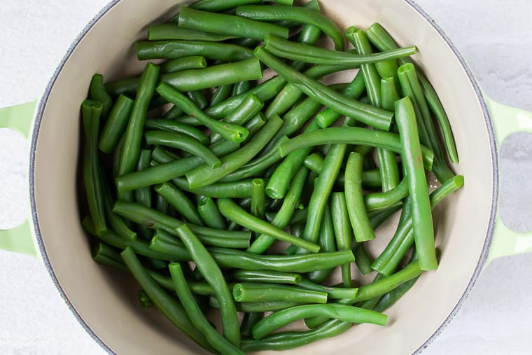 Cooked green beans in a Dutch oven