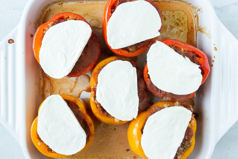 6 Bake stuffed peppers in a whit casserole dish topped with fresh mozzarella cheese.