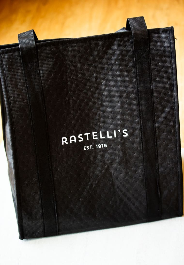 Black Rastelli's Bag over a white and tan backgound