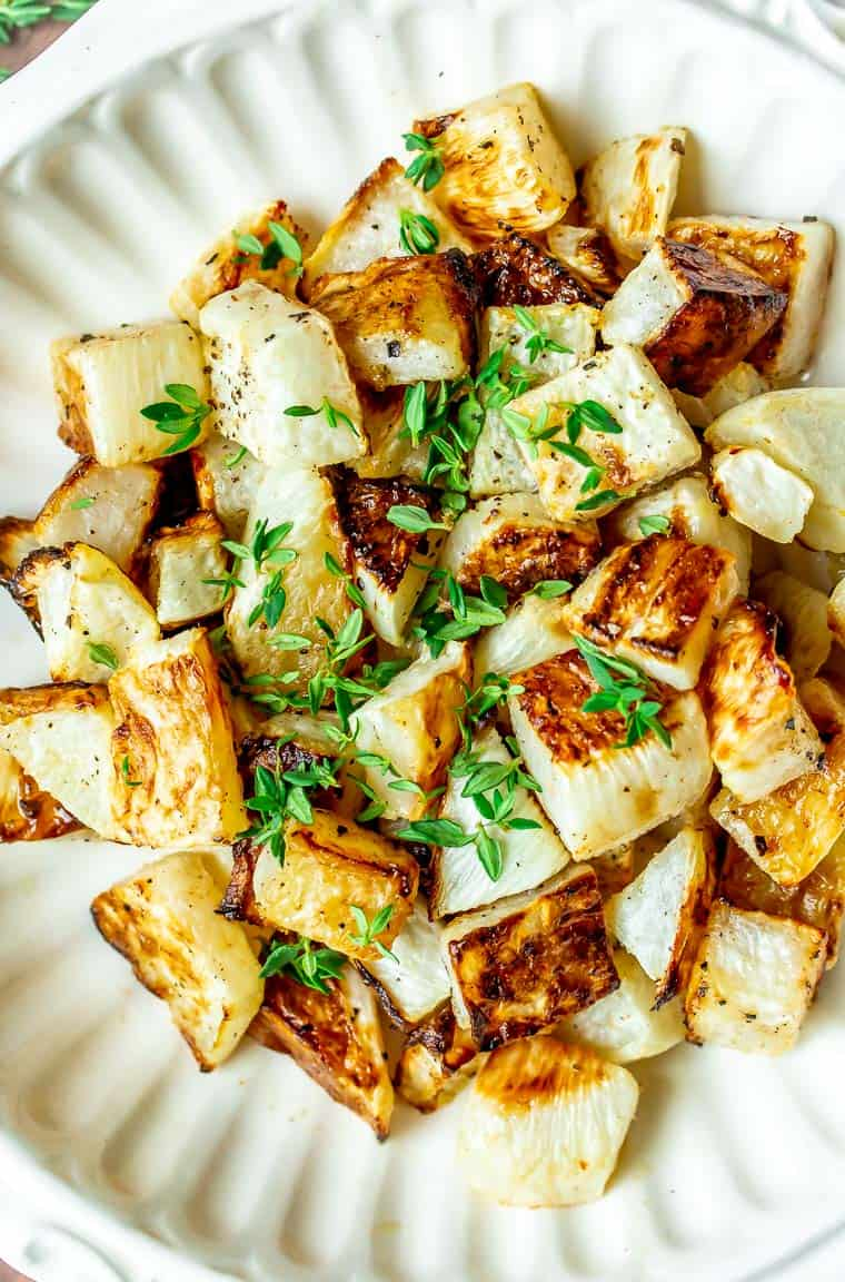 Close up of Roasted Turnips in a white bowl