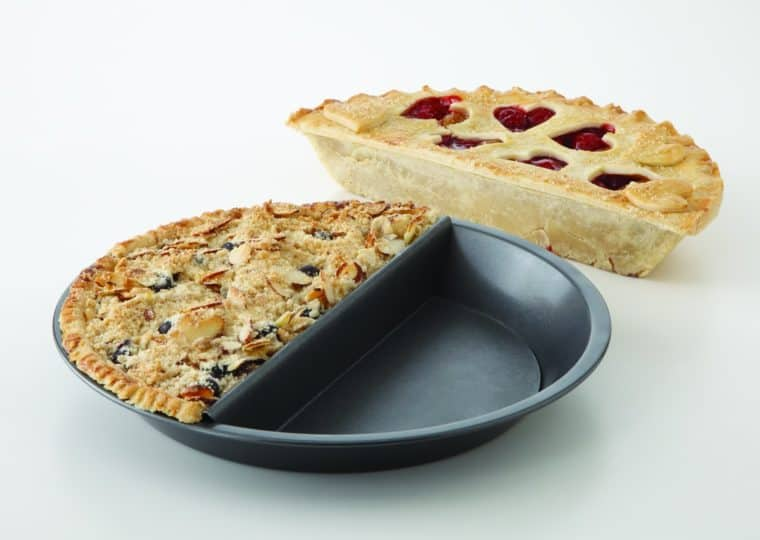 Split decision pie pan in use with 2 pies on a white background