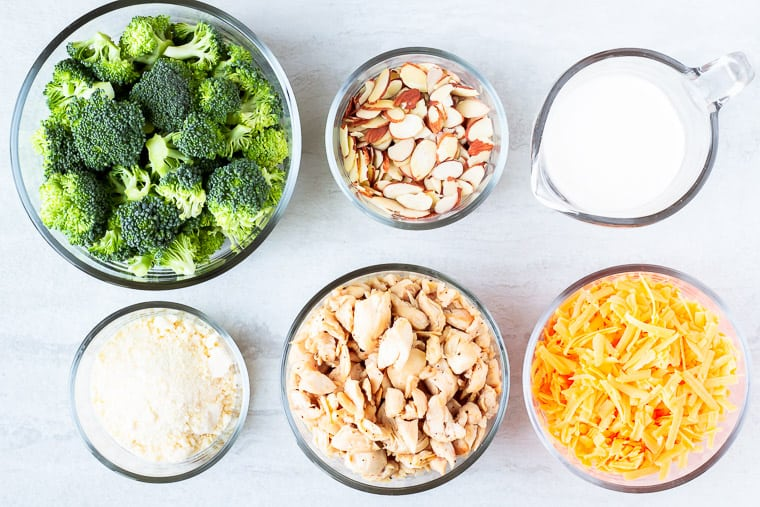 Ingredients needed for keto broccoli chicken bake on a white background