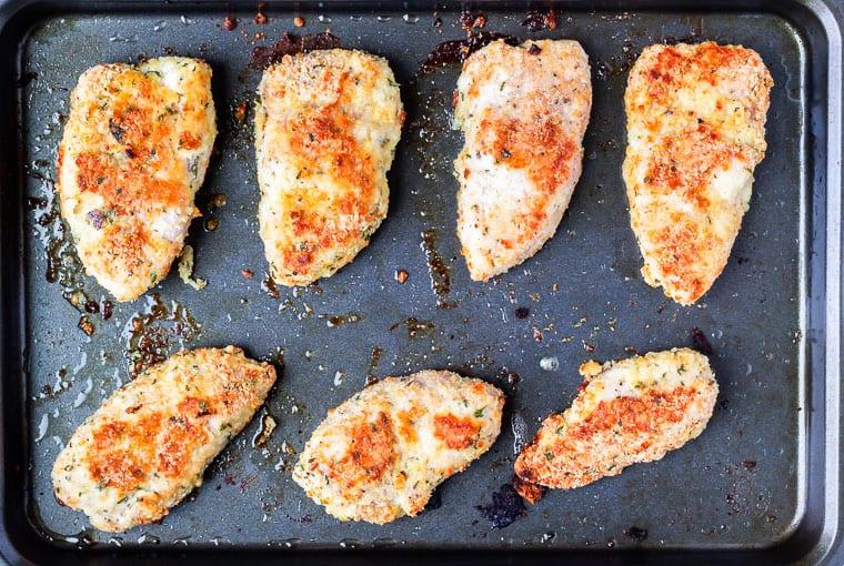 Baked turkey cutlets on a baking sheet