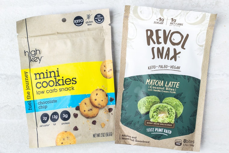 Revol Snax bag of Matcha Latte Coconut Bites and a bag of highkey mini chocolate chip cookies on a white background