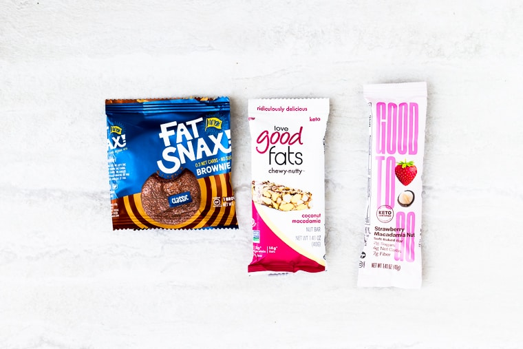 3 packages of keto snacks on a white background