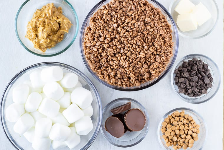 Ingredients needed to make chocolate peanut butter rice krispies treats in glass bowls over a white background