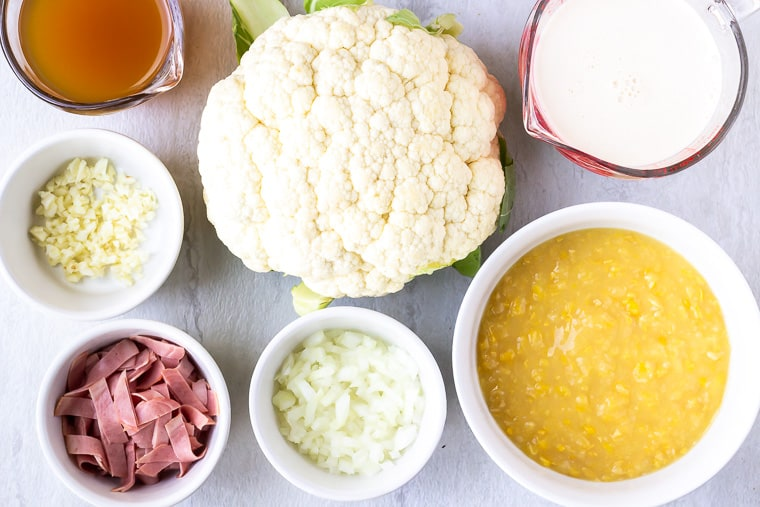 Ingredients needed to make Cauliflower Corn Chowder on a white background
