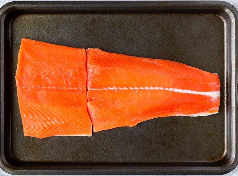 2 large salmon fillets on a baking sheet