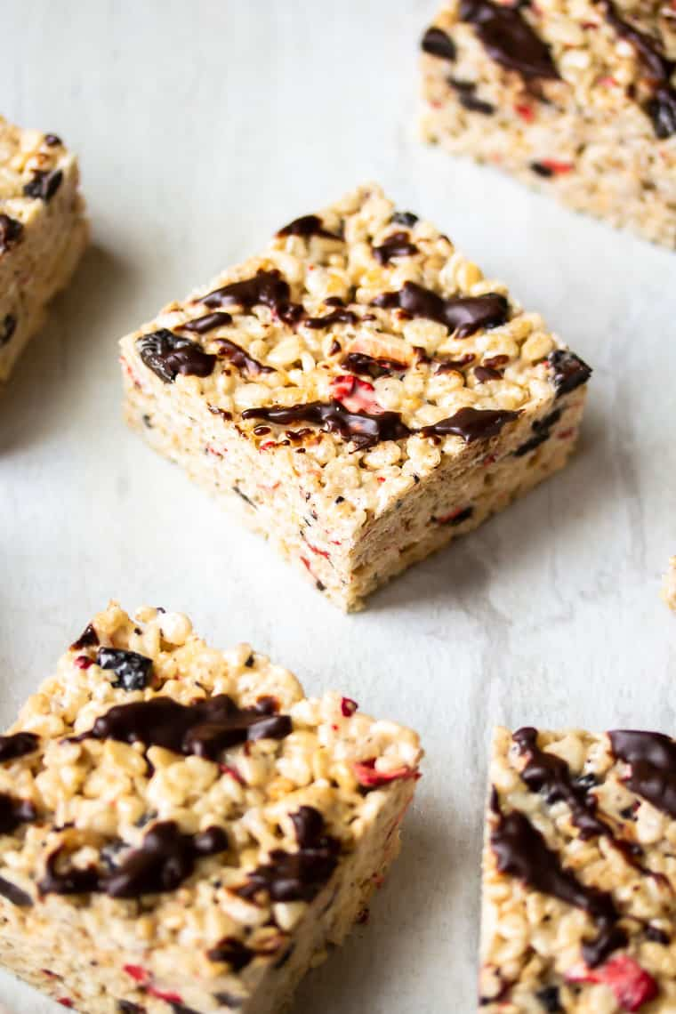 Chocolate Covered Strawberry Rice Krispie treats cut into bars on a white background