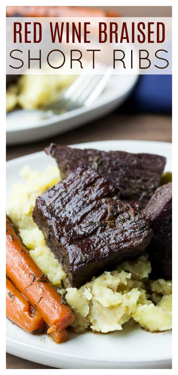 Red Wine Braised Short Ribs - slow cooked in the oven until fall-apart tender, these delicious beef ribs are sure to impress anyone who tried them! The red wine sauce is incredibly flavorful and the perfect compliment to the meat. This fancy dinner recipe is easy to make, but does take some time. Be sure to plan ahead - it's worth it! | #dlbrecipes #beefshortribs #shortribsrecipe #redwinebraisedribs #beef