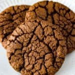 Close up of 3 gluten free chocolate cookies on a white plate