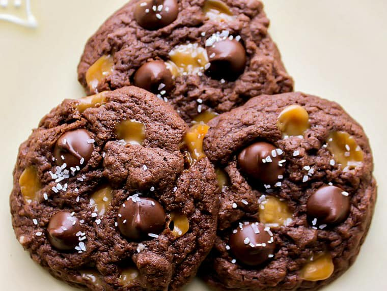 3 Gluten Free Salted Caramel Chocolate Chip Cookies Close Up on a White Background