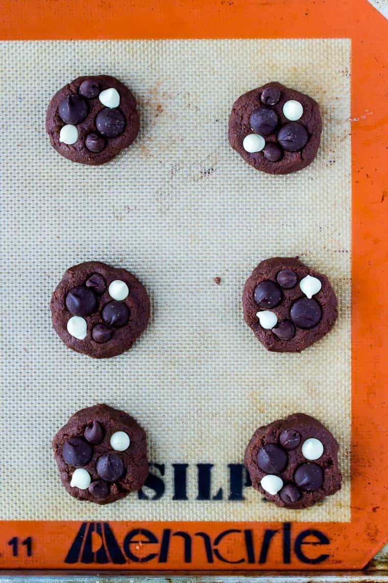 6 Gluten Free Triple Chocolate Chip Dough Balls on a Silpat Mat