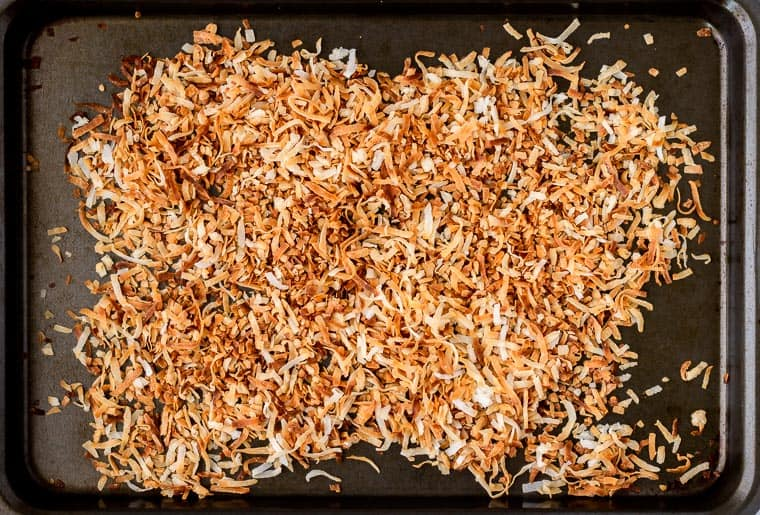 Toasted coconut shreds on a baking sheet