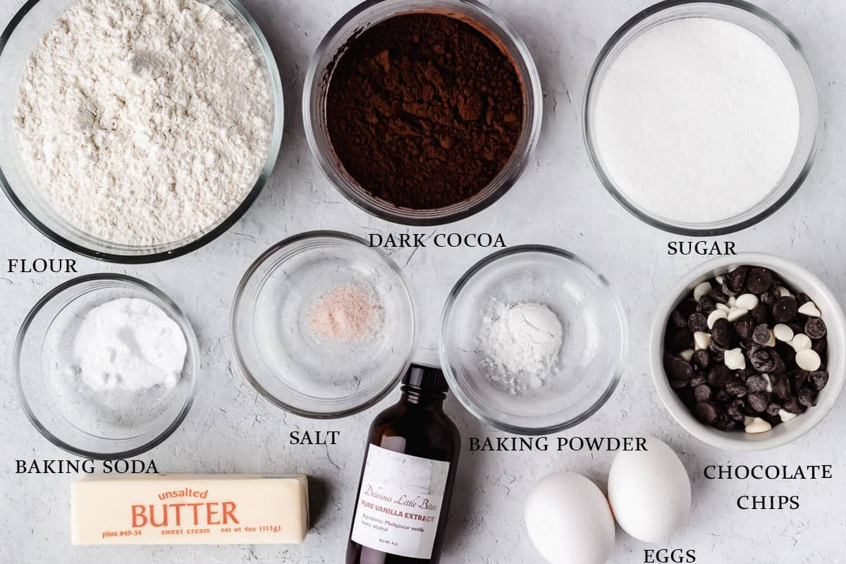 Ingredients to make triple dark chocolate chip cookies on a white background with labels