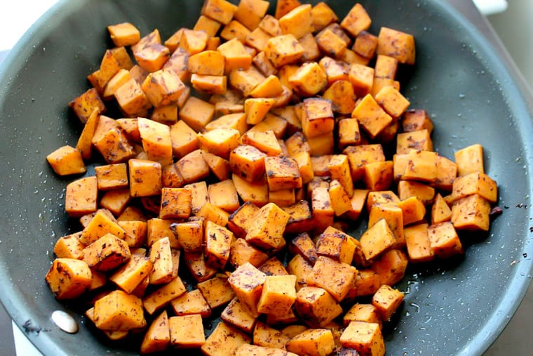 Close Up of Cubed Sweet Potatoes Cooked in a Skillet
