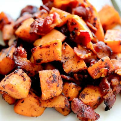 Maple Bacon Sweet Potato Hash on a White Plate with a Fork