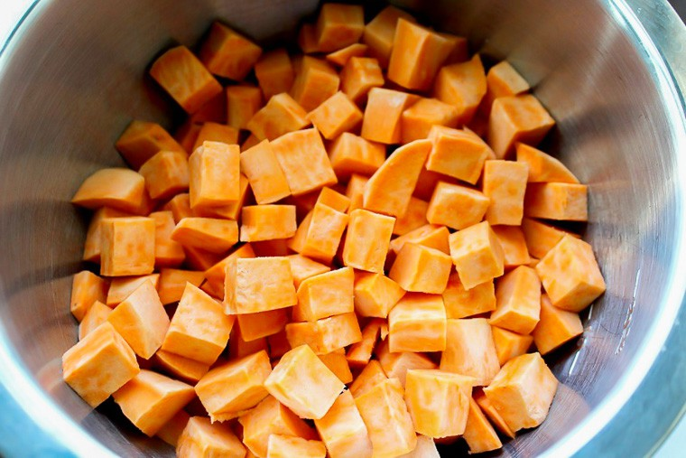 Cubed Sweet Potatoes in a Silver Bowl