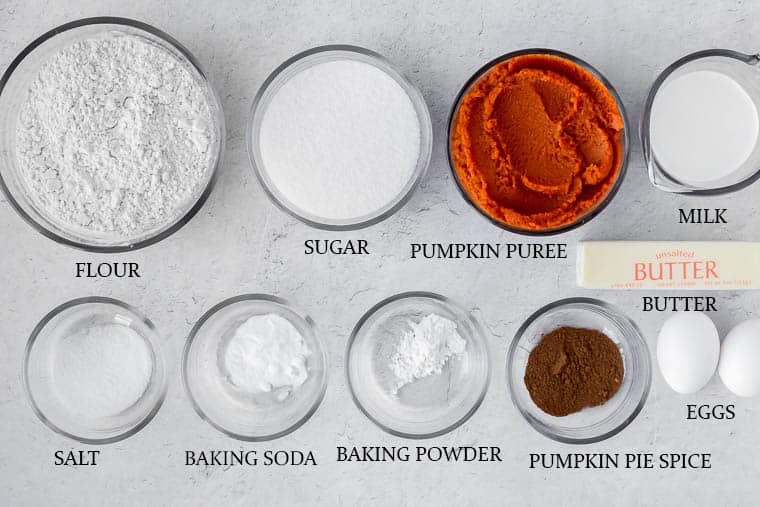 Ingredients for pumpkin spice cake on a white background with labels