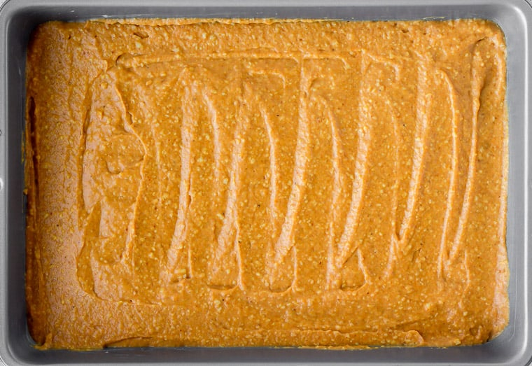 Pumpkin Cake batter spread into a cake pan