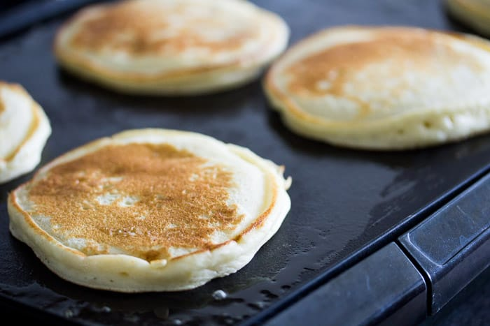 Pancakes Cooking on a Griddle