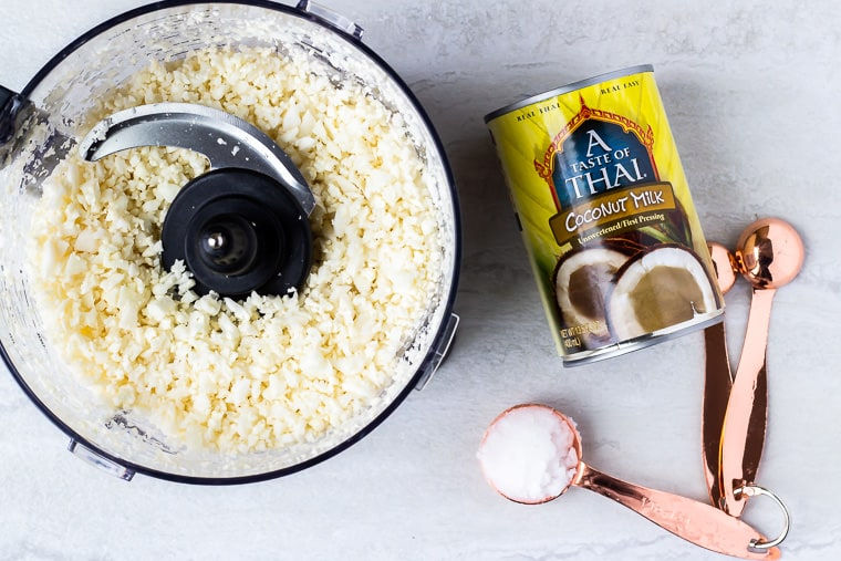 Ingredients needed to make coconut cauliflower rice on a white background