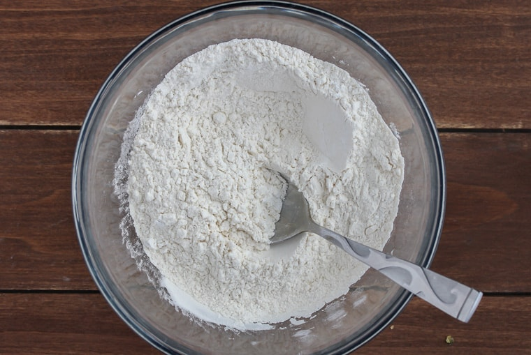 Dry cupcake ingredients in a silver bowl