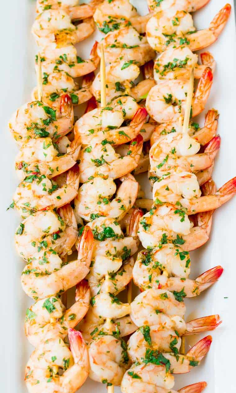 Close up of sweet chili lime shrimp on a white serving tray