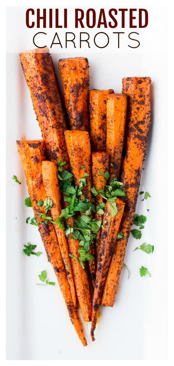 Chili Roasted Carrots are an easy side dish recipe! They pair great with chicken, pork, and steak. Or try adding them to your favorite vegetarian bowl recipes too! | #dlbrecipes #chiliroastedcarrots #roastedcarrots #carrots #carrotsidedish