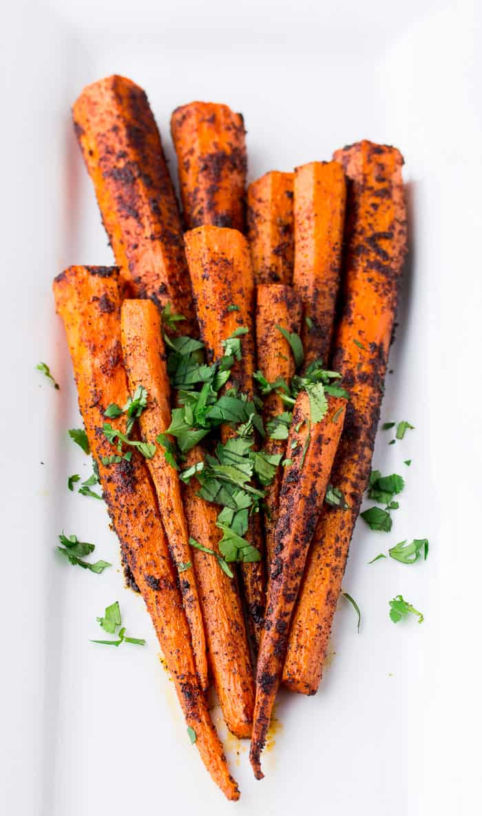 Roasted Chili Spiced Carrots with Cilantro on a White Plate