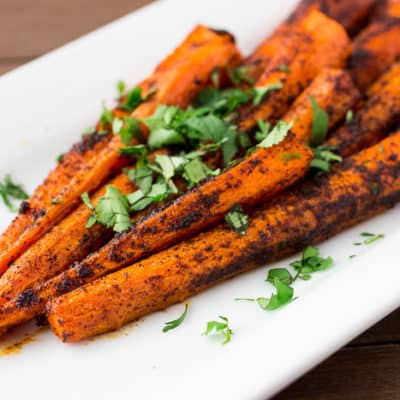 Roasted Chili Spiced Carrots on a White Plate with Cilantro