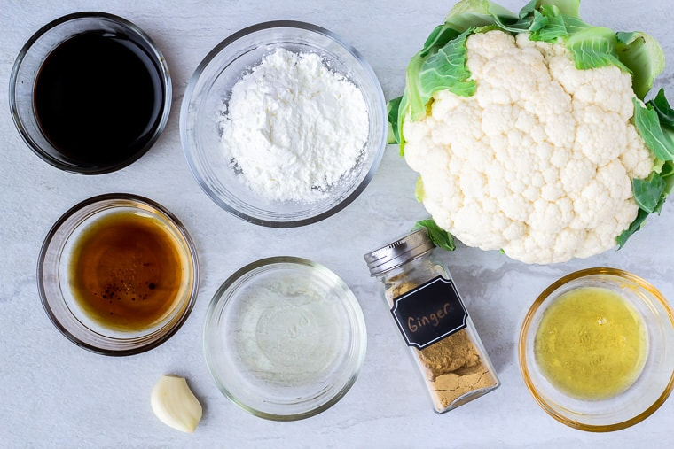 Ingredients needed for sesame cauliflower on a white background