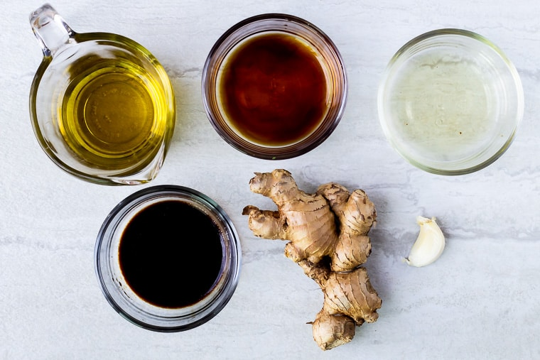 Ingredients for sesame ginger dressing on a white background