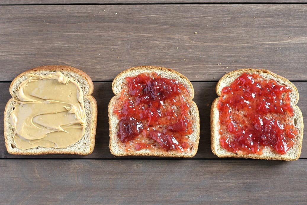 Bread Slices with Peanut Butter and Jelly on Them