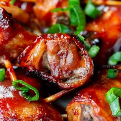 Close up of barbecue bacon wrapped beef bites with green onions