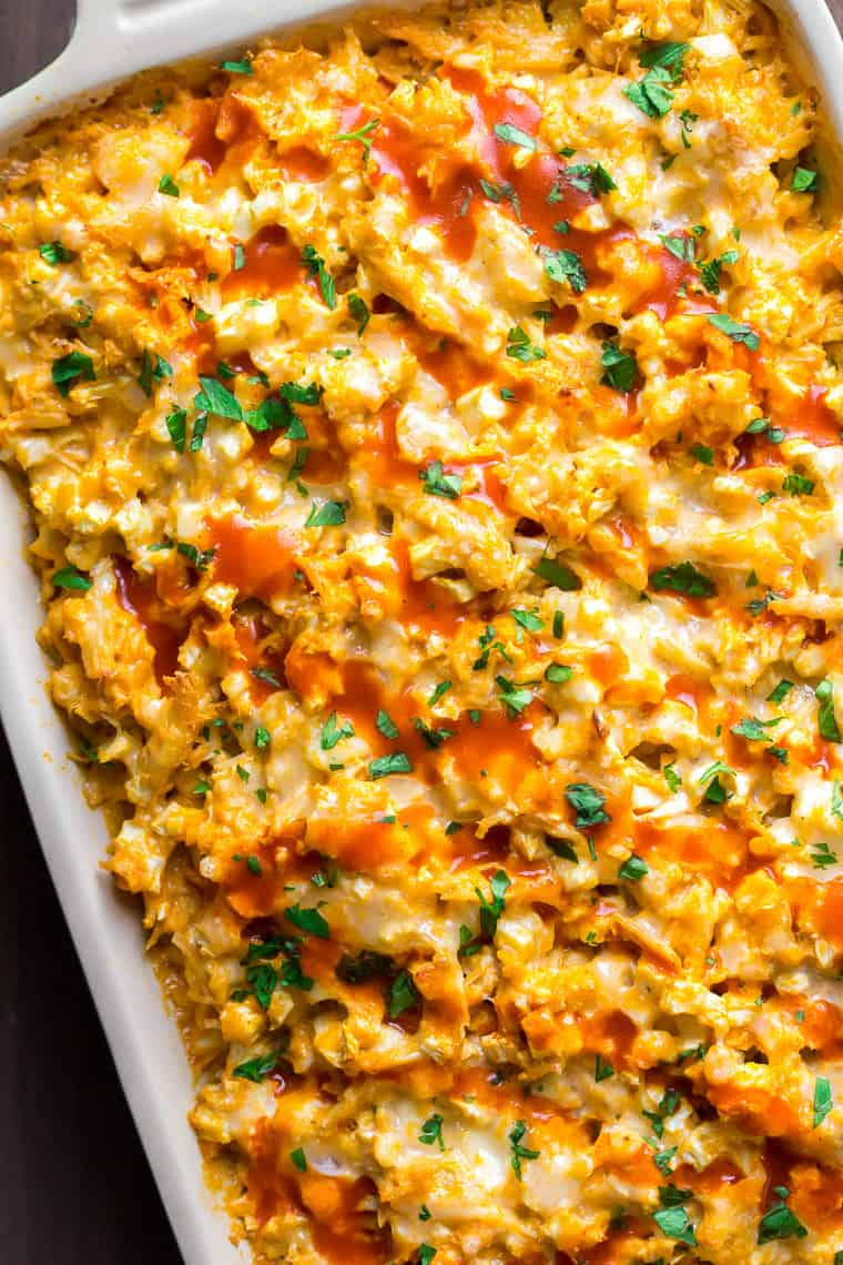 Closeup Overhead View Creamy Buffalo Chicken Cauliflower Casserole in a Baking Dish Angled Slightly