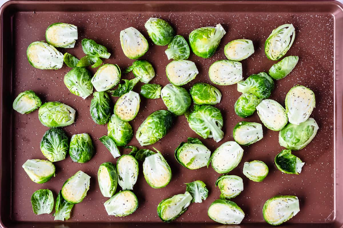 Raw brussels sprouts on a baking sheet
